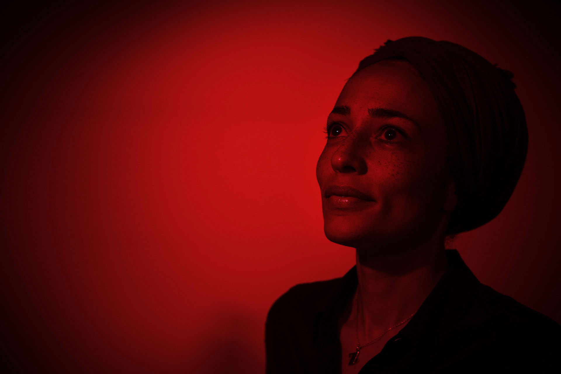 Photograph with red lighting of Writer Zadie Smith at Manchester Literary Festival portrait photographer Jon Parker Lee