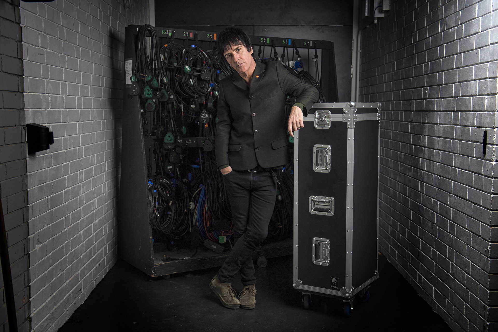 Photograph portrait of musician Jonny Marr at Royal Northern College of Music RNCM, Musician portrait Photography Jon Parker Lee
