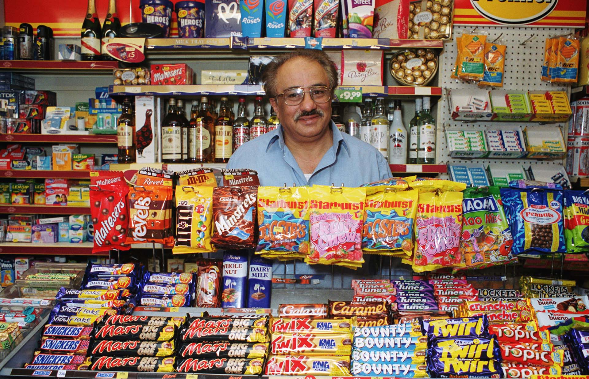 Photograph of corner shop owner sweet display colour photography Jon Parker Lee