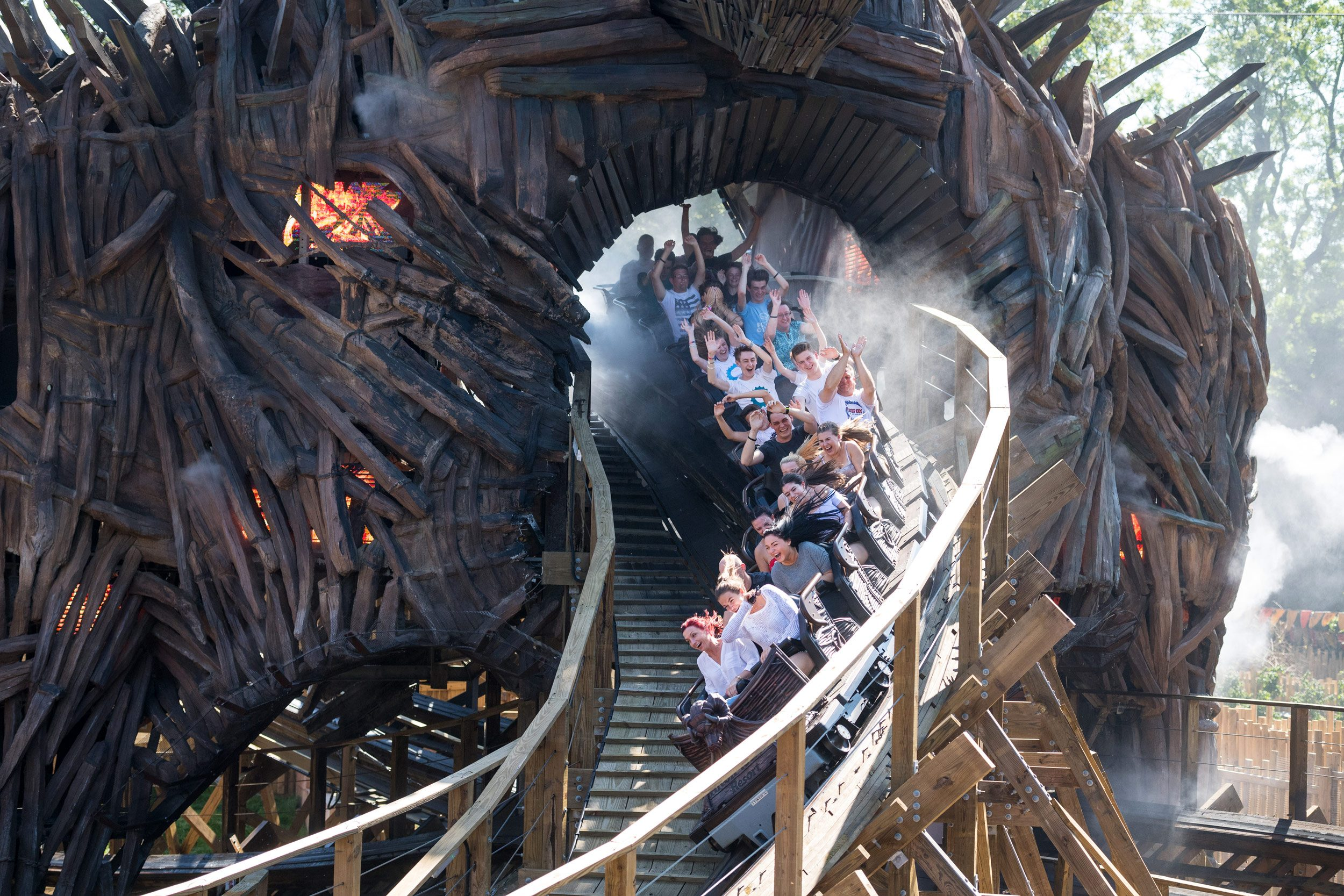 people scream as they ride on Alton Towers new rode, the wicker man, a wooden rollercoaster.
