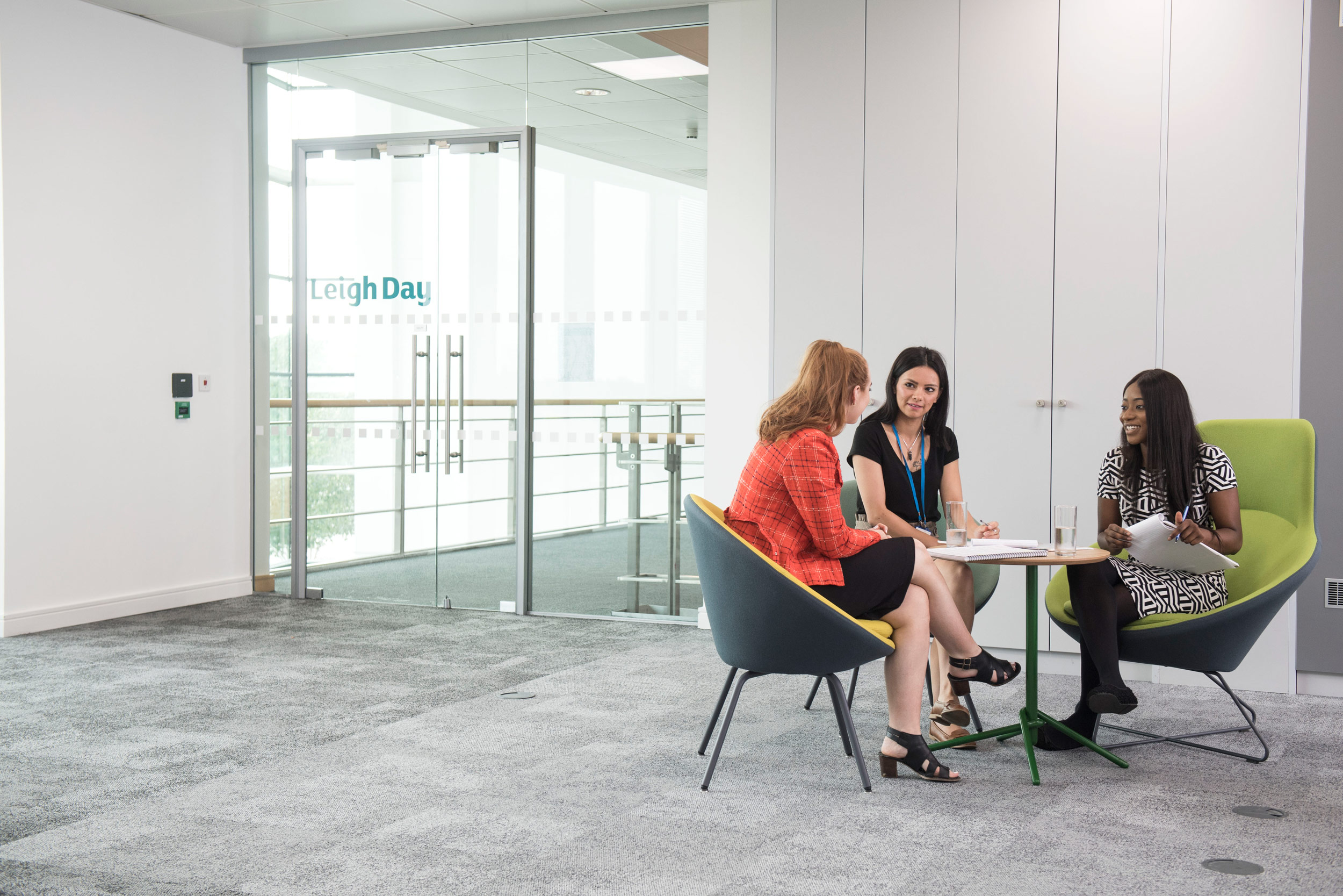 A group of solicitors hold a meeting in their new Manchester office