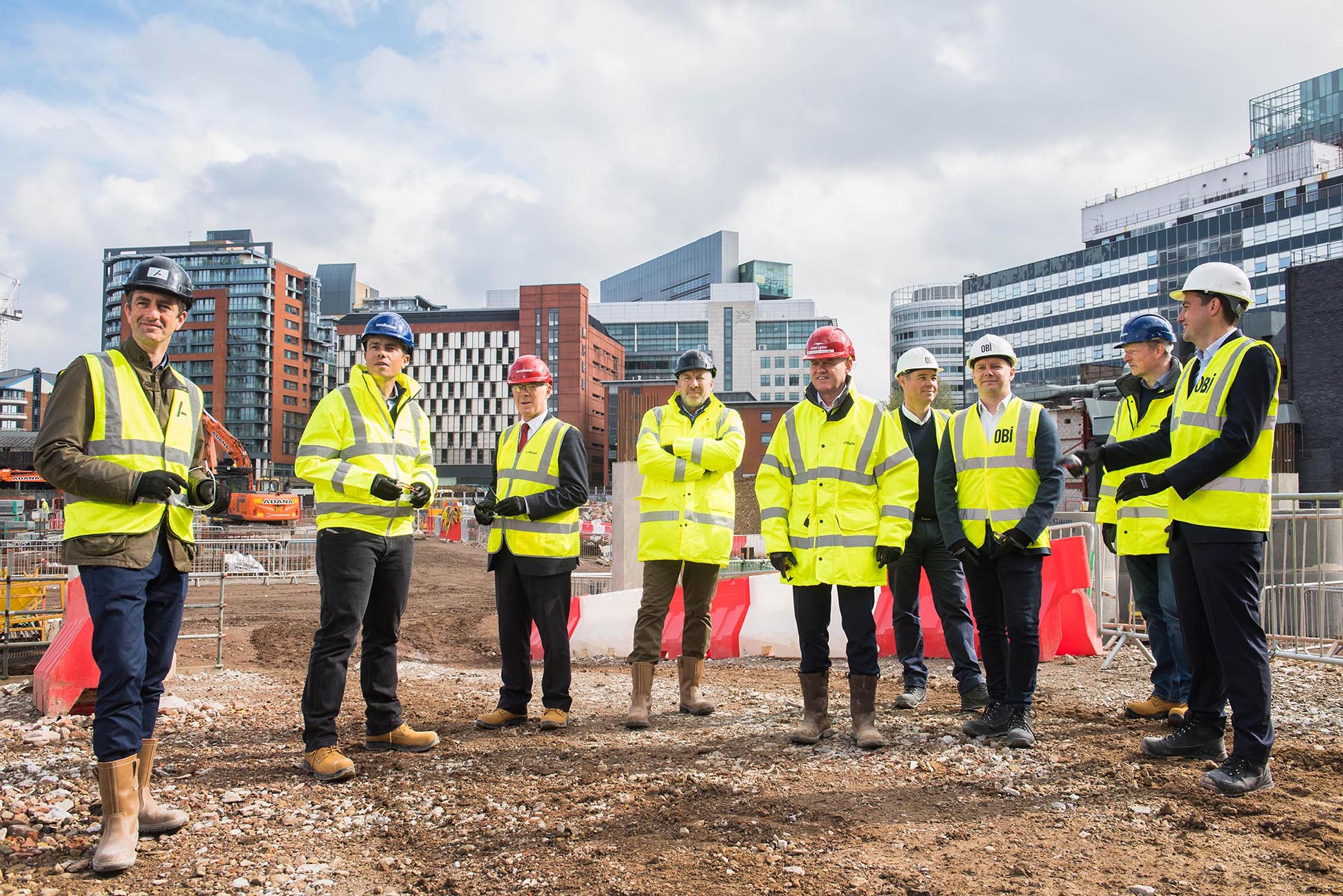 Business leaders meet at construction site in Salford.